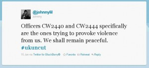 Officers CW2440 and CW2444 specifically are the ones trying to provoke violence from us. We shall remain peaceful. #ukuncut