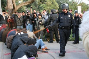 Police pepper-spray seated protesters