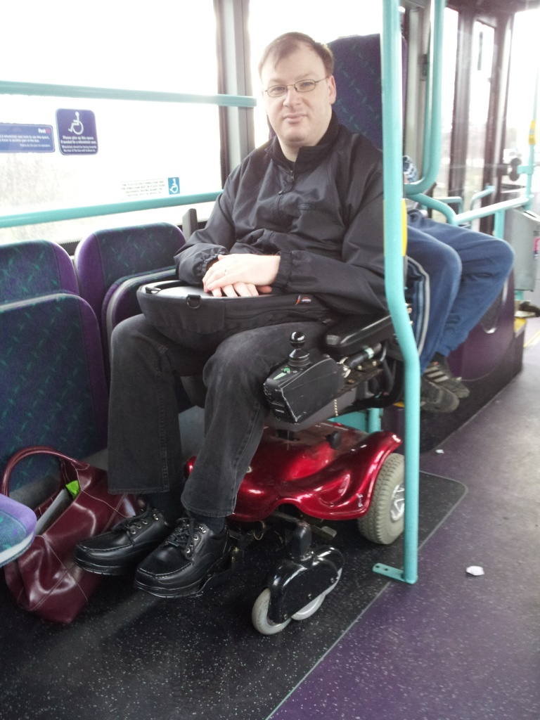 Me on a bus in a wheelchair!