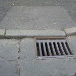 A surface drain in front of a dropped kerb
