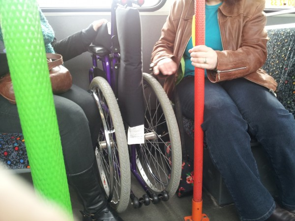 Folded wheelchair on a bus